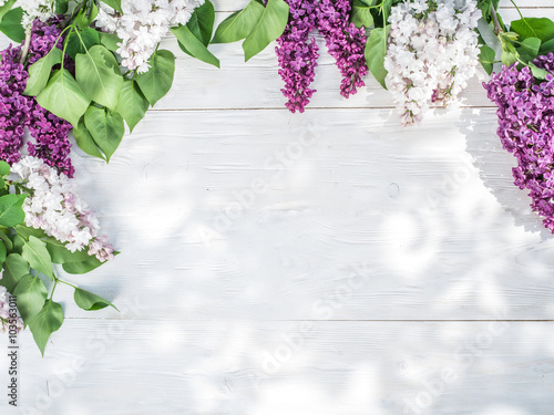 Blooming lilac flowers on the old wooden table. Plakat
