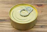 canned food on brown wooden background