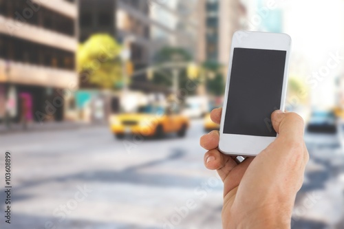 Foto op Plexiglas New York TAXI Composite image of male hand holding a smartphone