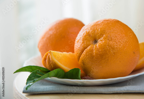 orange fruit and green leaves isolated on white background Poster