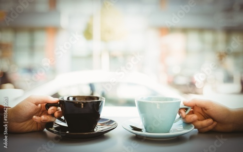 Friends holding cup of coffee - 103623065