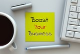 Boost Your Business, message on note paper, computer and coffee on table