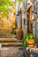 Idyllic view of an mediterranean rustic house and stone stairs