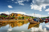 Wooden boats on the Thu Bon River in Hoi An, Vietnam