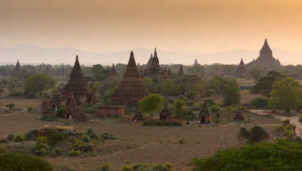 Pagoda under a warm sunset in the plain of Bagan, Myanmar (Burma)