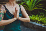 A Young woman doing meditation outdoors in tranquil environment - 103675034