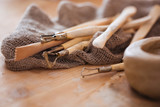 Set of dirty craft sculpting tools in pottery workshop - 103705699