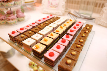 Delicious minicakes on candy bar