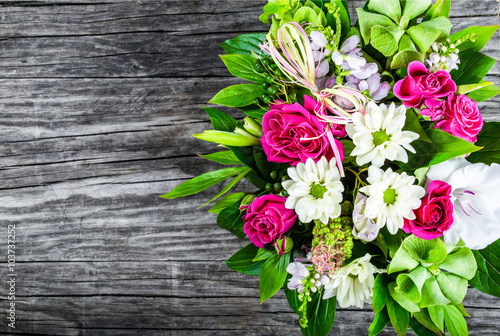 Aluminium Gerbera wedding bouquet with roses and white gerberas on an old wooden t