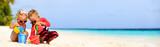 cute little boy and toddler girl play on beach