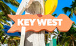 Key West welcome sign with palm trees