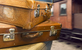 Vintage suitcases at train station - 103882459