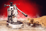 professional manual silver coffee machine with cup of coffee, stamper and sack coffee beans on red background, product protography for coffee shop