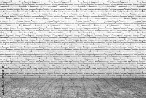 Fototapeta pavimento in cemento e muro in mattoni bianchi