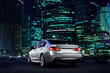 Modern car stay near Moscow City district at night
