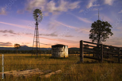 obraz lub plakat Windmill in the countryside of Queensland, Australia.
