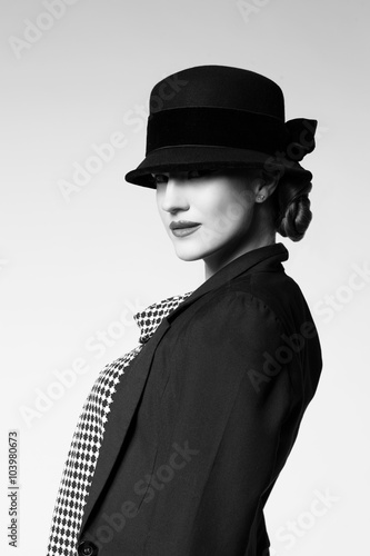 Retro girl in jacket and hat