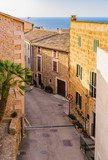 Street with mediterranean buildings and ocean view