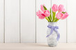 Fresh pink tulips in a  jug - 103985059