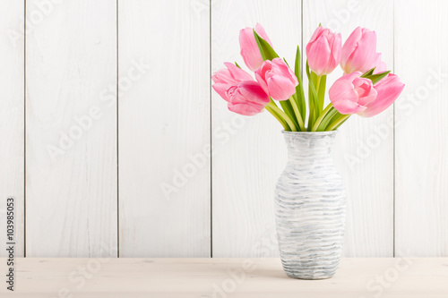 Fresh pink tulips in a  jug Poster