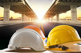 Fototapety safety helmet on civil engineering working table against bridge