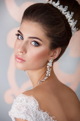 gorgeous bride with crown jewelry , girl in wedding dress fashion model