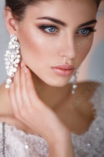 gorgeous bride with crown jewelry , girl in wedding dress fashion model © armina