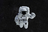 Fototapety Spaceman travels on a background of stars. Astronaut outer space