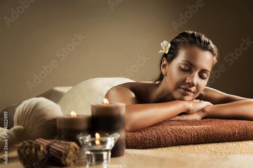 Fototapeta The girl relaxes in the spa salon