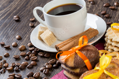 Biscuits and coffee on table Poster
