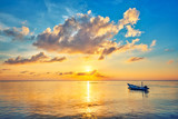 Fototapety Colorful sunrise over ocean on Maldives