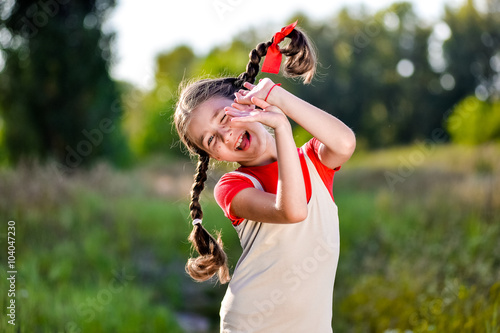 girl with pigtails imagines the summer on the nature Poster
