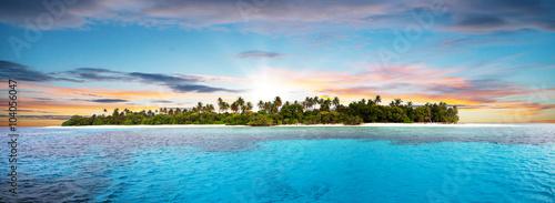 fototapeta na ścianę Beautiful nonsettled tropical island in sunset