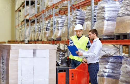 Poster Industrial geb. worker and businessmen with clipboard at warehouse