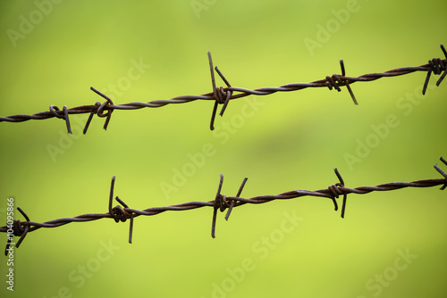 Poster lines of barbed wire to demarcate the border