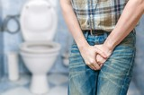 Incontinence concept. Man wants to pee and is holding his bladder.