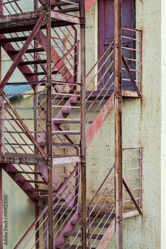Fototapeta exterior fire escape stairs on manufacturing building
