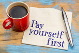 pay yourself first - text on napkin