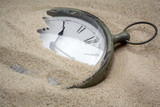 Fototapety Time concept with a cklock on the sand