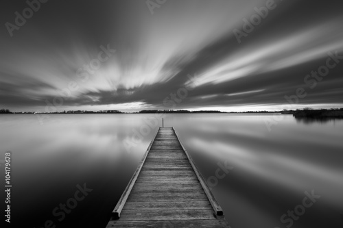 Plagát Jetty on a lake in black and white