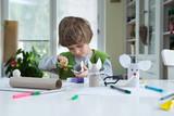 Little boy being creative - 104201096