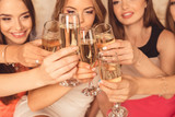 Close up photo of girls celebrating a bachelorette party and cli - 104202483