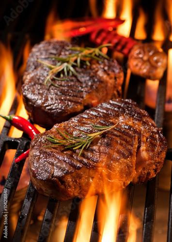 Fototapeta Beef steaks on the grill