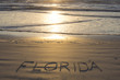 Florida written on sandy beach