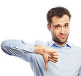 Disappointed young business man with thumb down. - 104253046