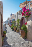 Santorini - The street of Oia with the souvenirs shops and restaurants. - 104283408