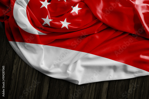 Poster Singapore flag on wooden table