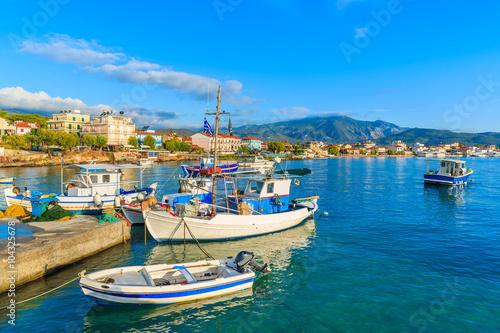 Aluminium Greek fishing boats at sunrise in small port, Samos island, Greece