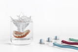 Dentures concept with glass, mask and toothbrush - 104330866