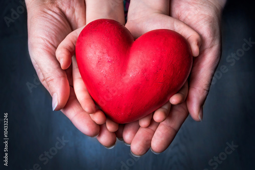 Zdjęcia na płótnie, fototapety, obrazy : Red Heart on Palm of Woman and Child - Mother Day Symbol